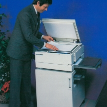 Man operating Xerox 2830